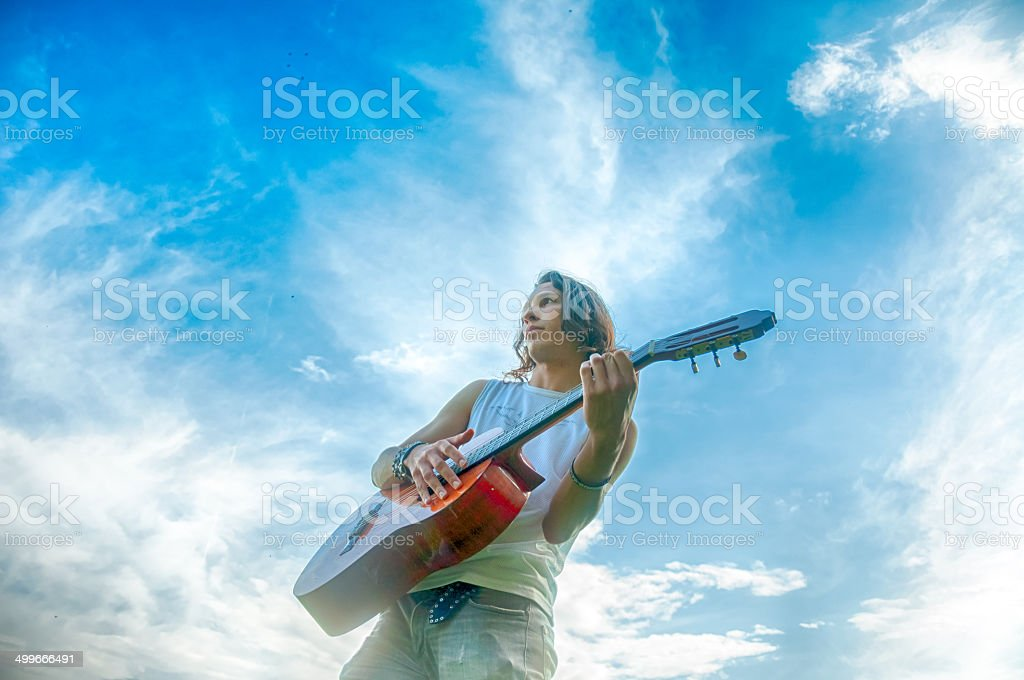 guitarist playing outdoors royalty-free stock photo