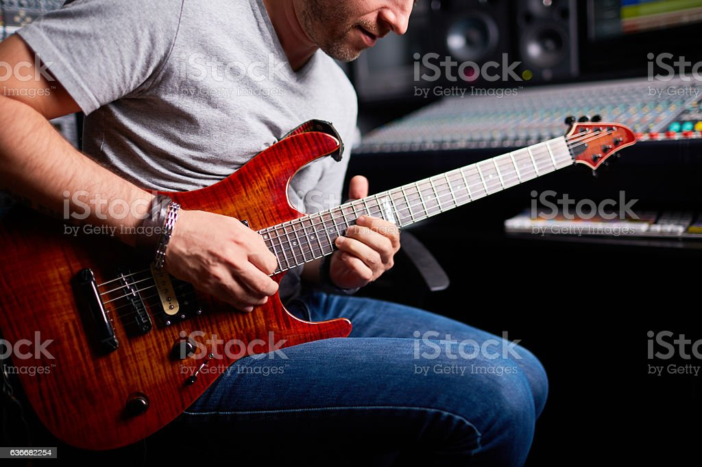 Guitarist playing stock photo