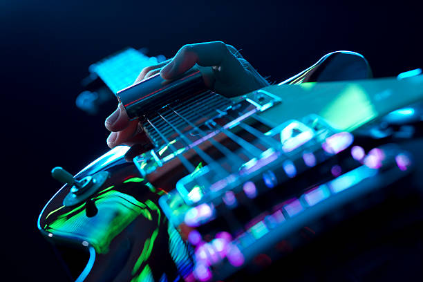 guitarist playing slide guitar - rock music stock pictures, royalty-free photos & images