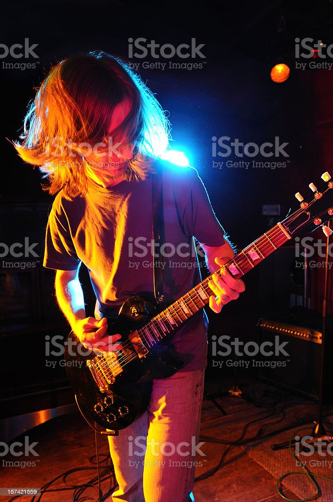 Guitarist playing solo royalty-free stock photo