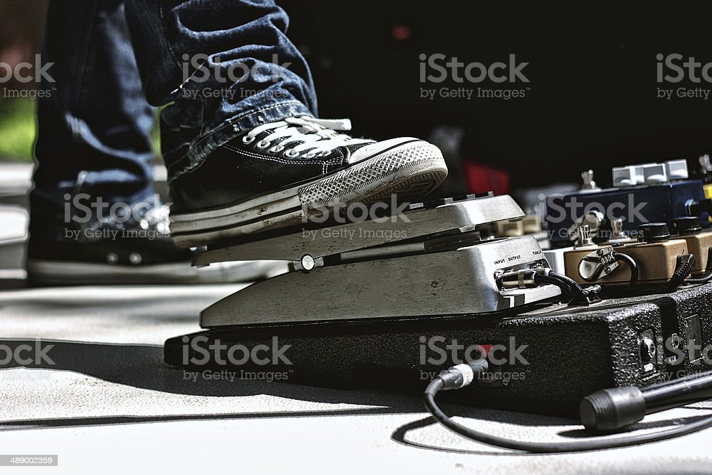 Guitarist with Chuck Taylors and a Pedal Board stock photo