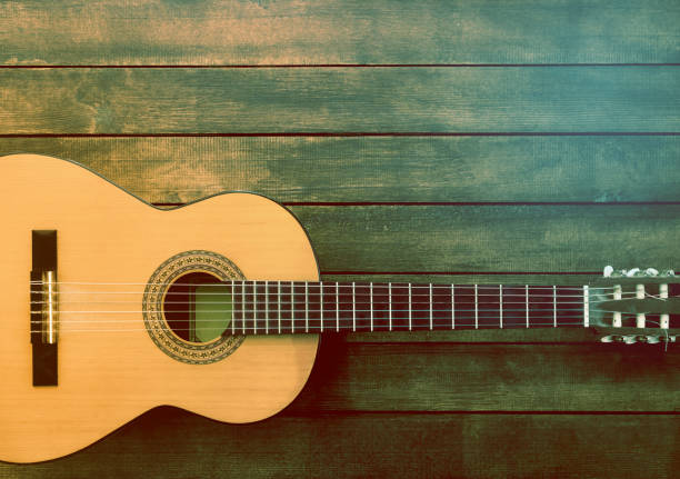 Guitaron the Wooden Background Guitaron the Wooden Background country and western music stock pictures, royalty-free photos & images