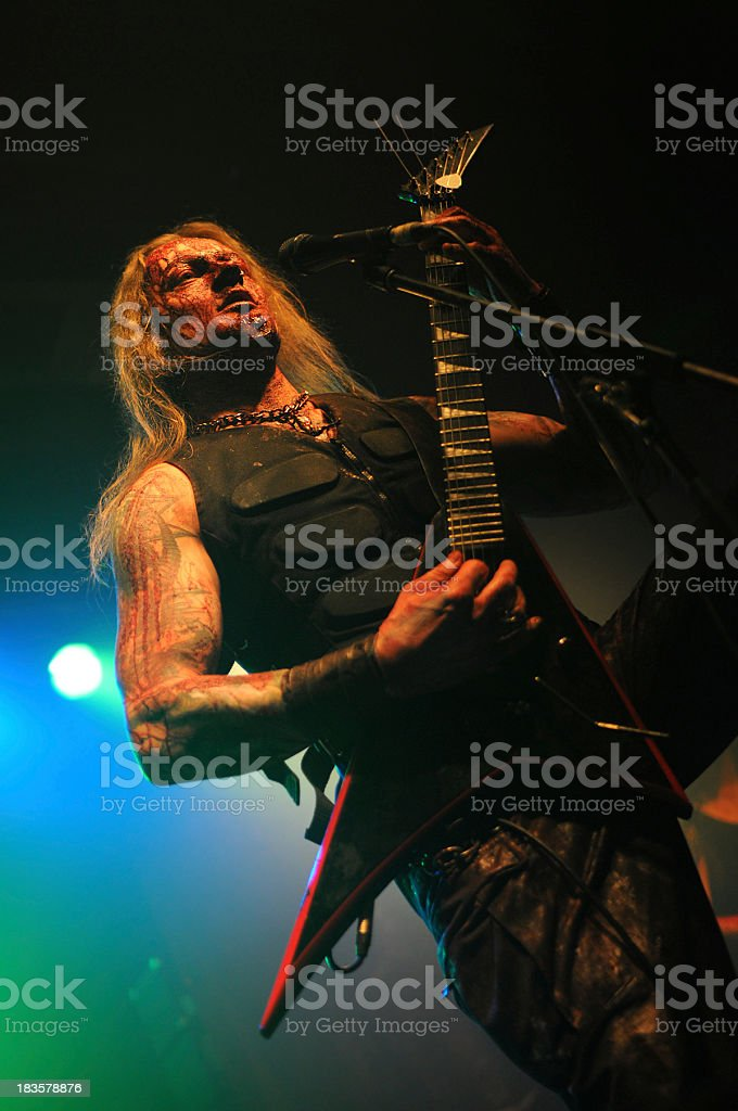 guitarrist and vocalist of metal band at club Concert royalty-free stock photo