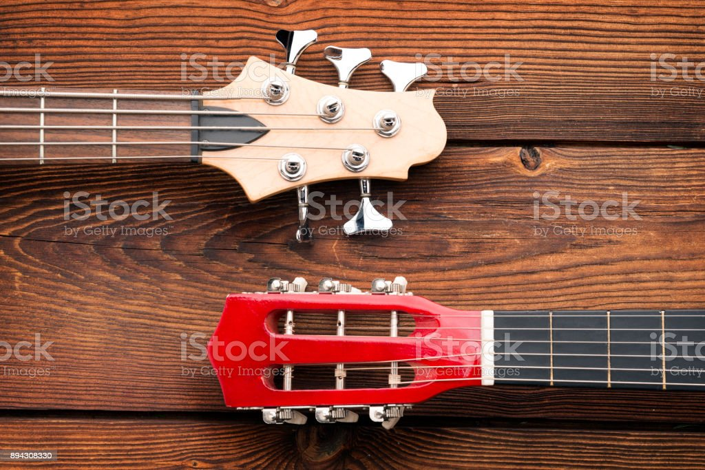 Guitars neck on a wooden background stock photo