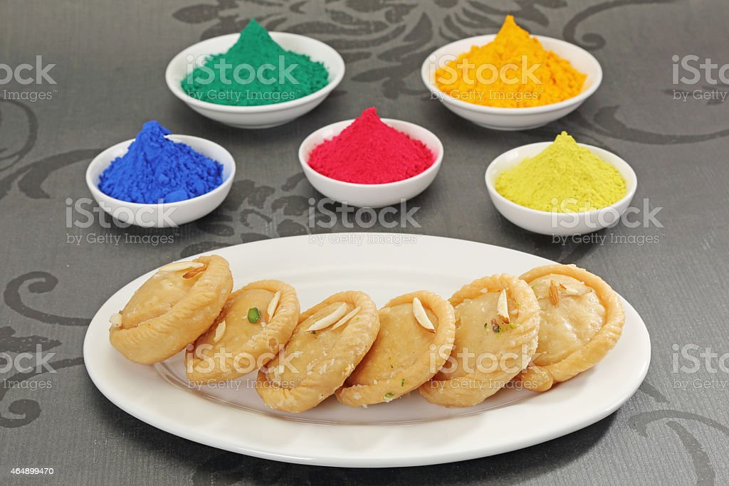 Gujiya with Gulal or Face Powder at Holi stock photo