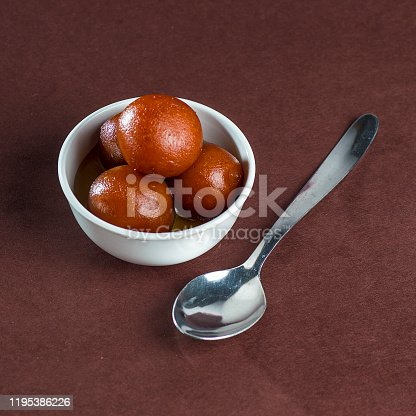 istock Gulab Jamun, Indian Dessert or Sweet Dish in bowl with spoon 1195386226