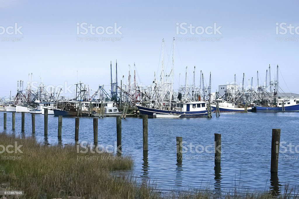 Gulf coast shrimp boats in dock stock photo