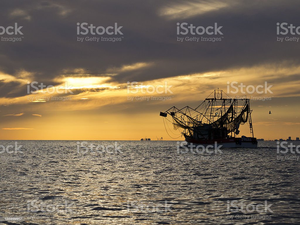 Gulf Coast Shrimping Boat Leaving Port stock photo