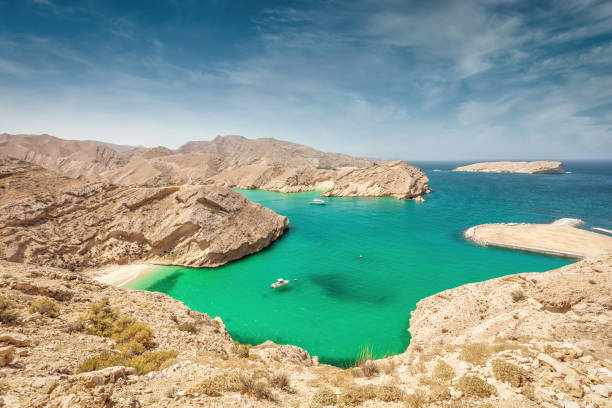Gulf of Oman Coast Green Lagoon with Small Hidden Beach Oman stock photo