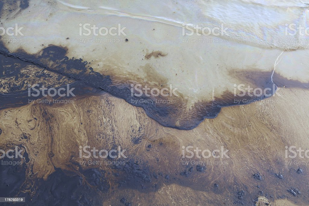 Gulf oil spill is shown on a beach royalty-free stock photo