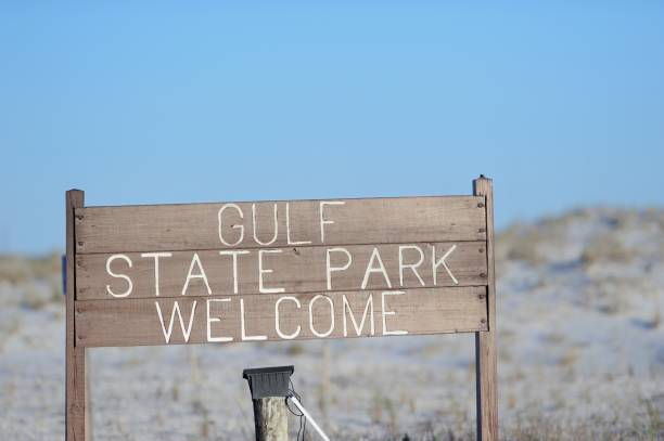 Gulf State Park Welcome sign on road near beach stock photo