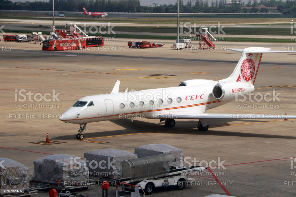 Gulfstream aerospace gv-sp (g550) the white plane parking at the Airport. stock photo