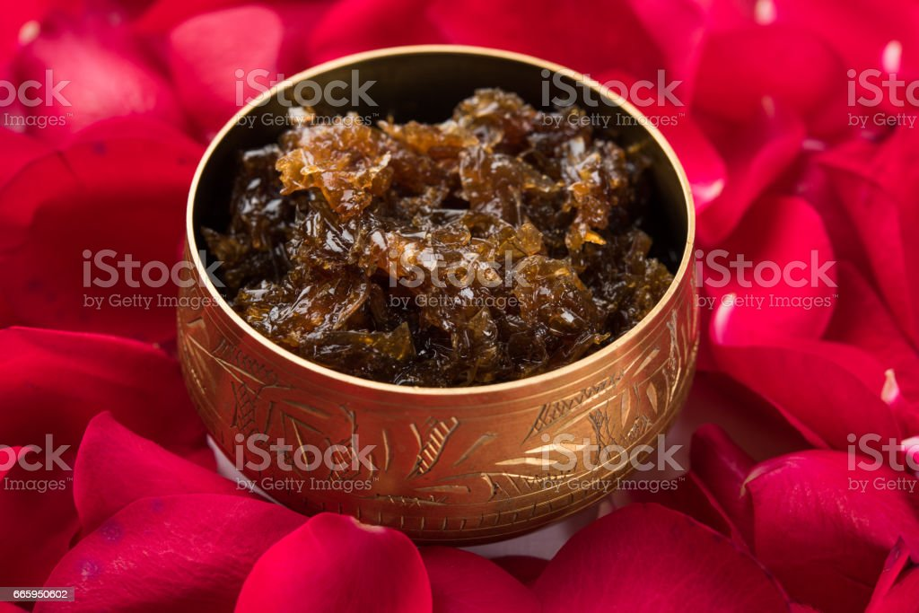 Gulkand, also known as Gulqand, is a sweet preserve of rose petals popular in India, usually used in chewing paan masala. stock photo
