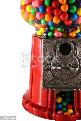 Nostalgic looking gum ball machine full of colorful gumballs.