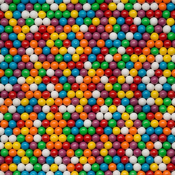 gumballs background seamless tile - sakız şekerleme stok fotoğraflar ve resimler