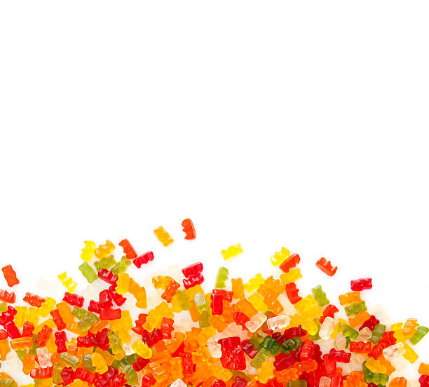 gummibears on white background gummibears on white background. Assortment of colorful fruity Gummy Bears isolated on white background jujube candy stock pictures, royalty-free photos & images