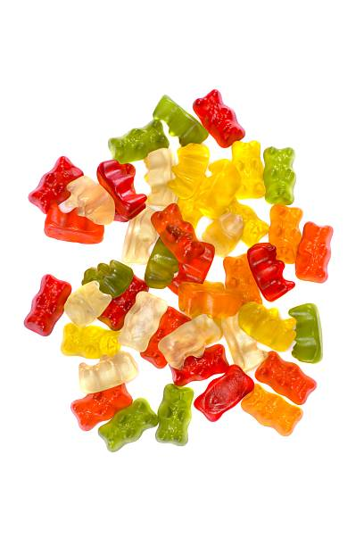 Gummy bears heap on white background gummi bears stack on white background jujube candy stock pictures, royalty-free photos & images