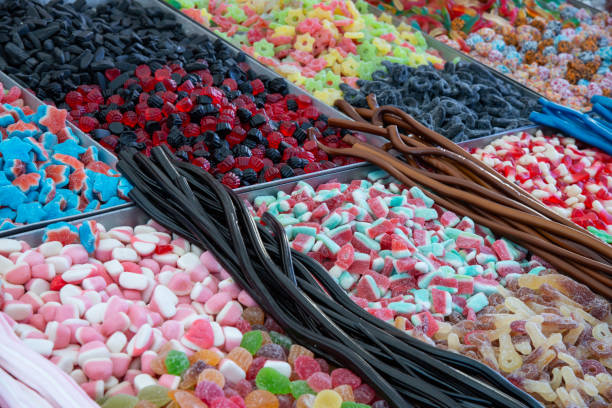 Gummy candies and liquorice for sale at the market. stock photo