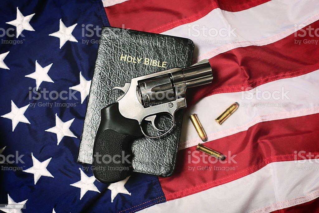 Gun and Bible on American Flag stock photo