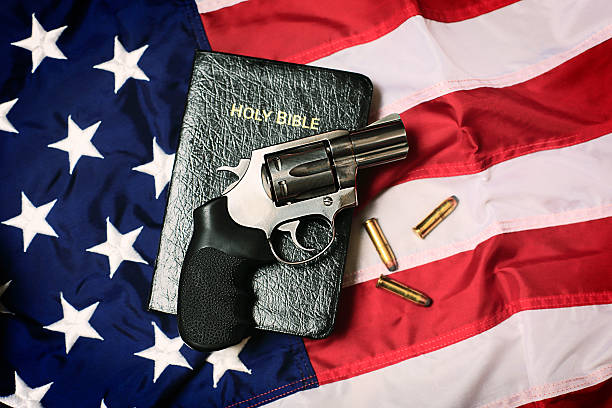 Gun and Bible on American Flag