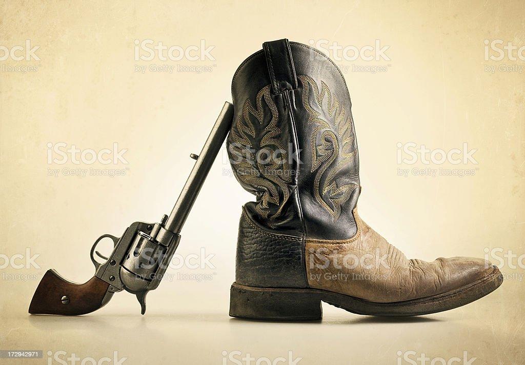 gun and boot stock photo