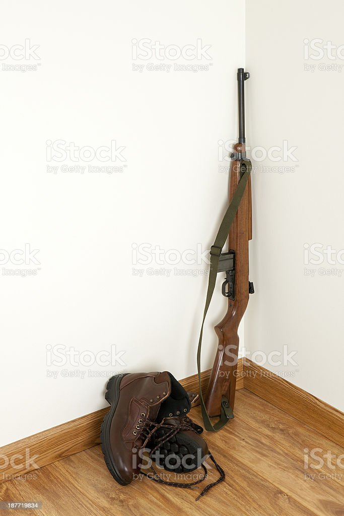 Gun and Boots stock photo