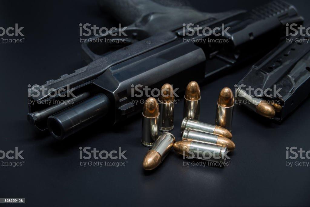 Gun and bullet. stock photo