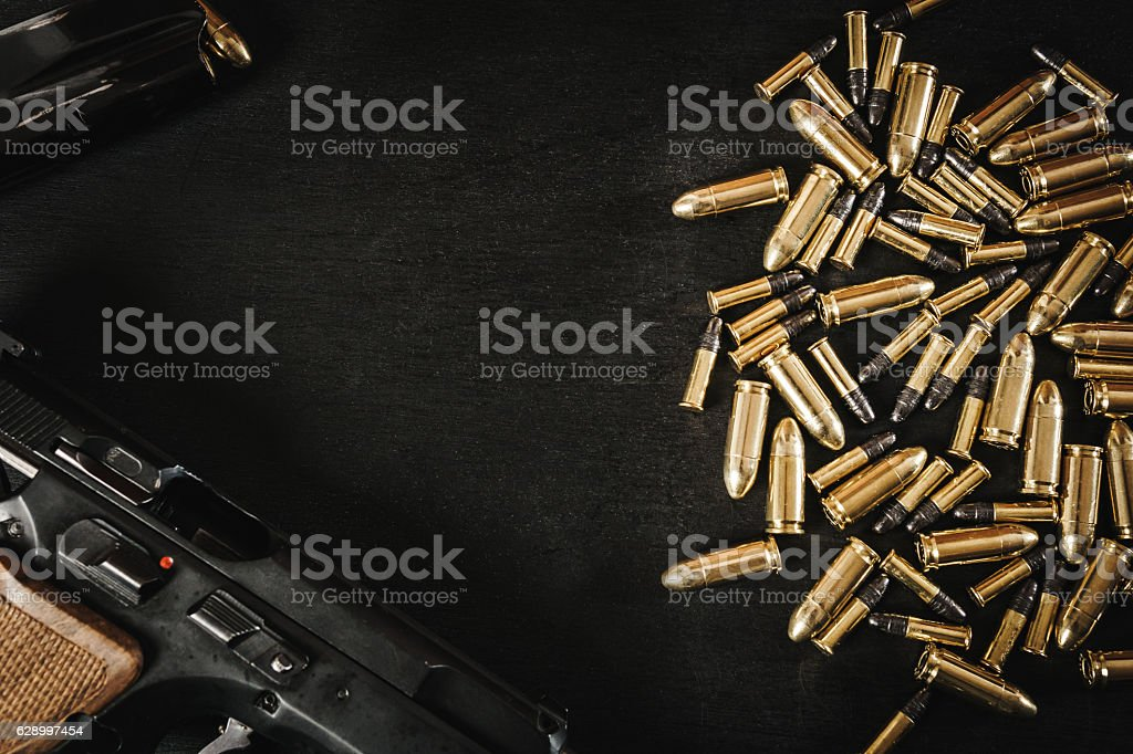 gun and bullets on the table stock photo
