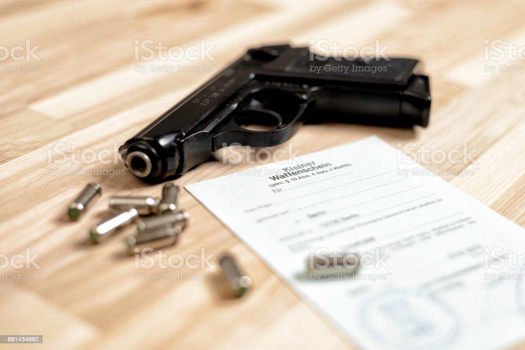 gun and license stock photo