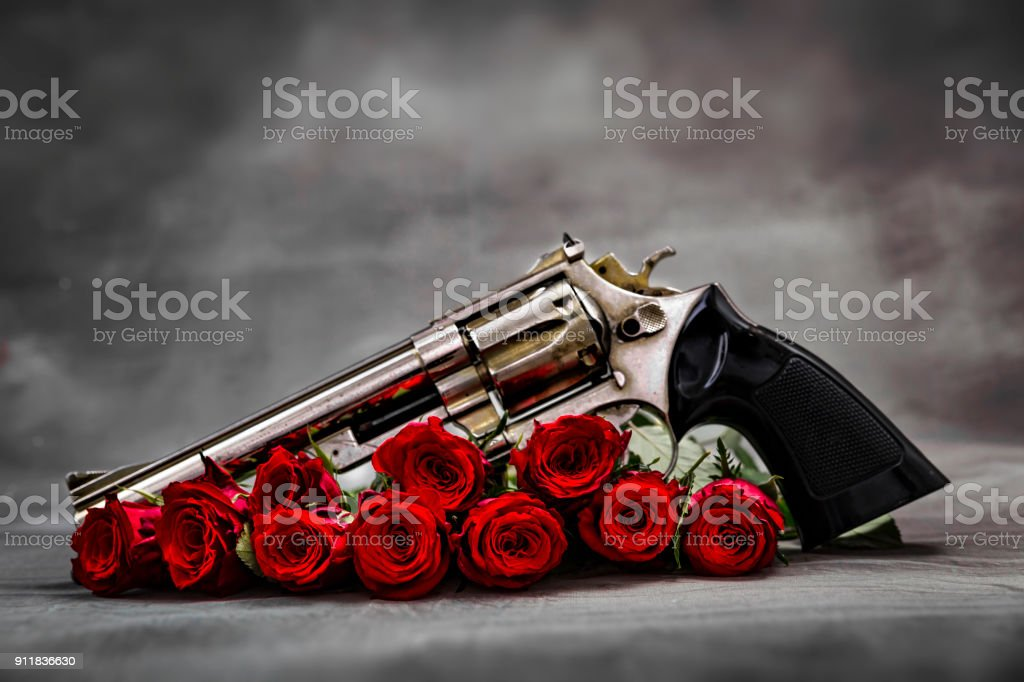 Gun and roses stock photo