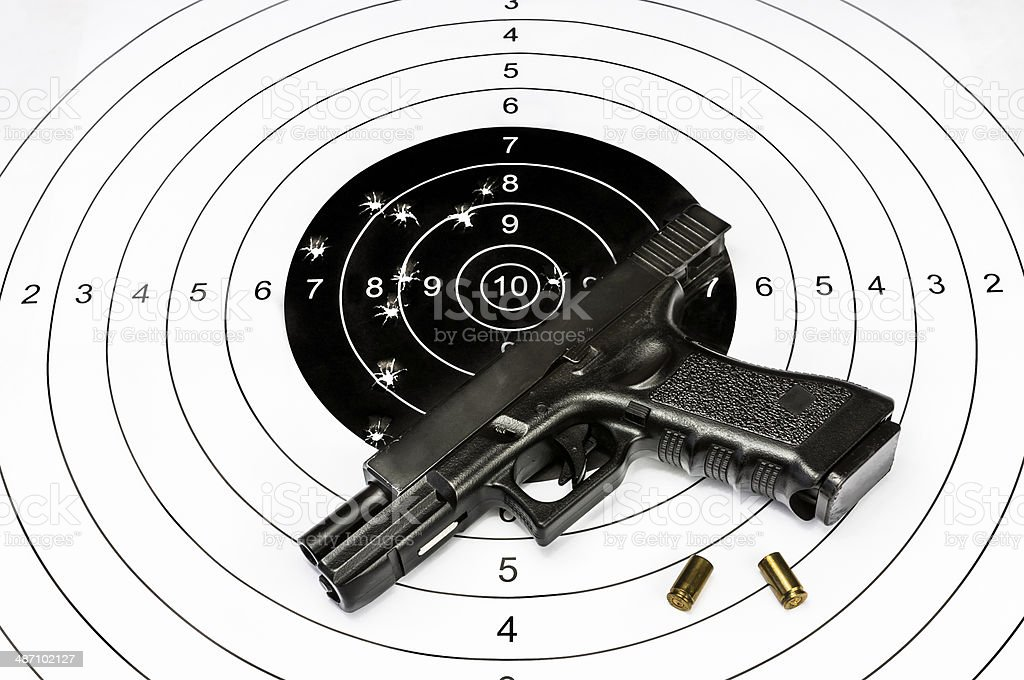 Gun and shooting target stock photo