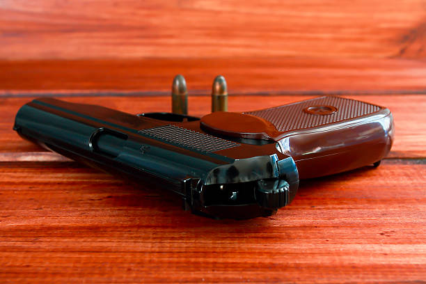 Gun and Two Bullets stock photo
