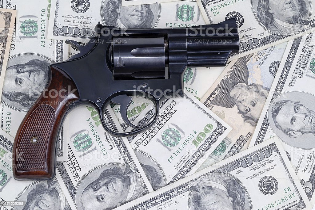 Gun and US bills royalty-free stock photo
