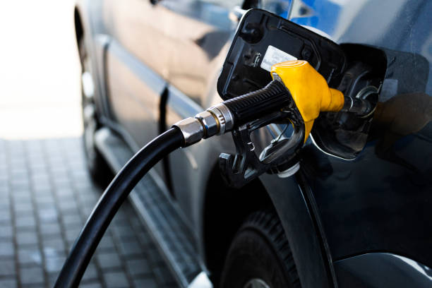 gun at the gas station is inserted into the tank of the car gun at the gas station is inserted into the tank of the car biodiesel stock pictures, royalty-free photos & images