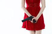 A gun behind woman back