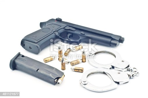 istock Gun bullet and handcuff isolated. 451121577