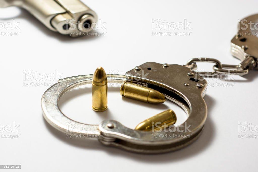 Gun bullet and handcuff stock photo