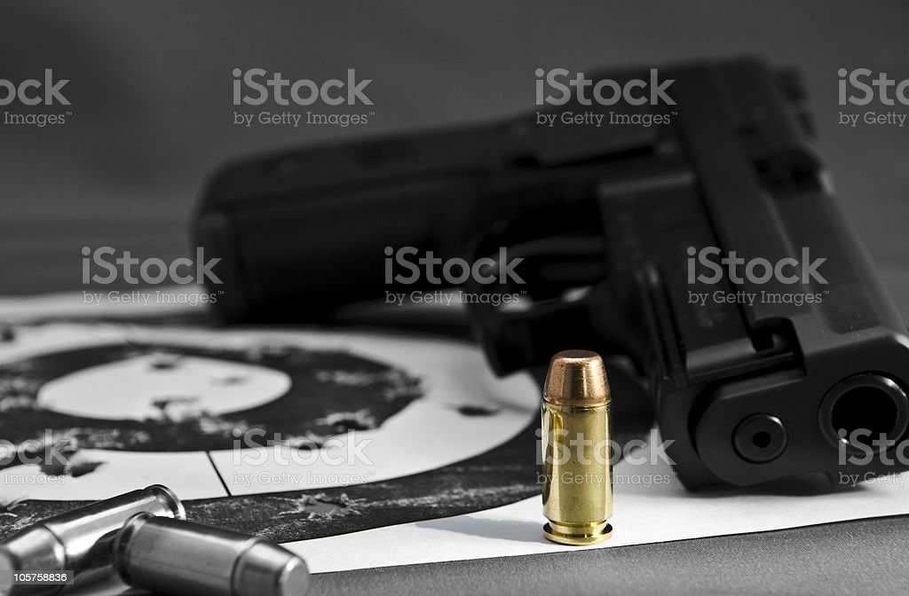 Gun Bullet and Target royalty-free stock photo