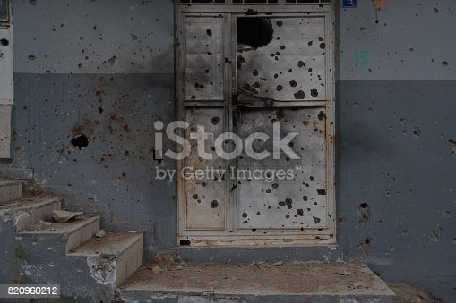 695022520 istock photo Gun bullet-riddle and Door 820960212