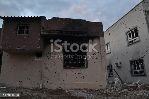 istock Gun bullet-riddle und burned with bomb buildings 517811010