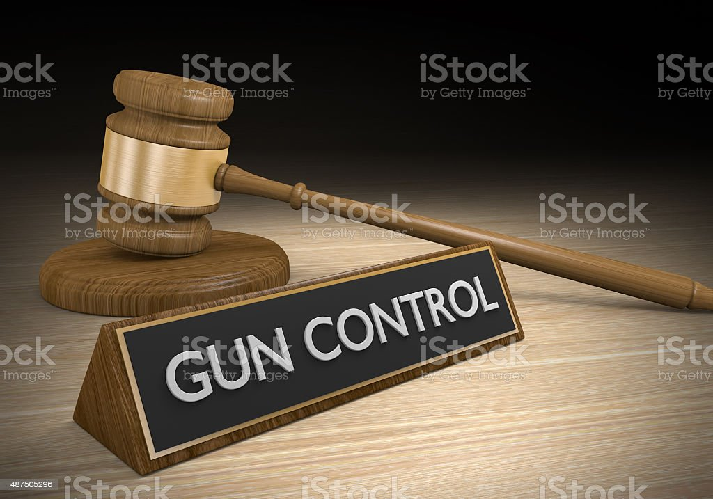 Gun control laws and court legal battle concept stock photo