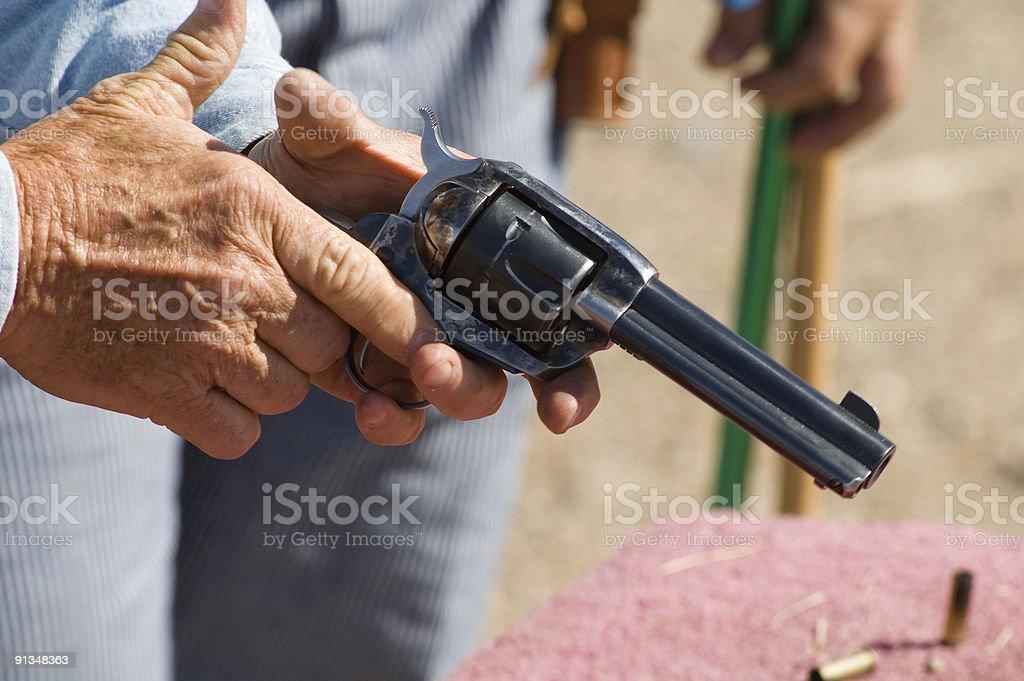 Gun in hand 4 royalty-free stock photo