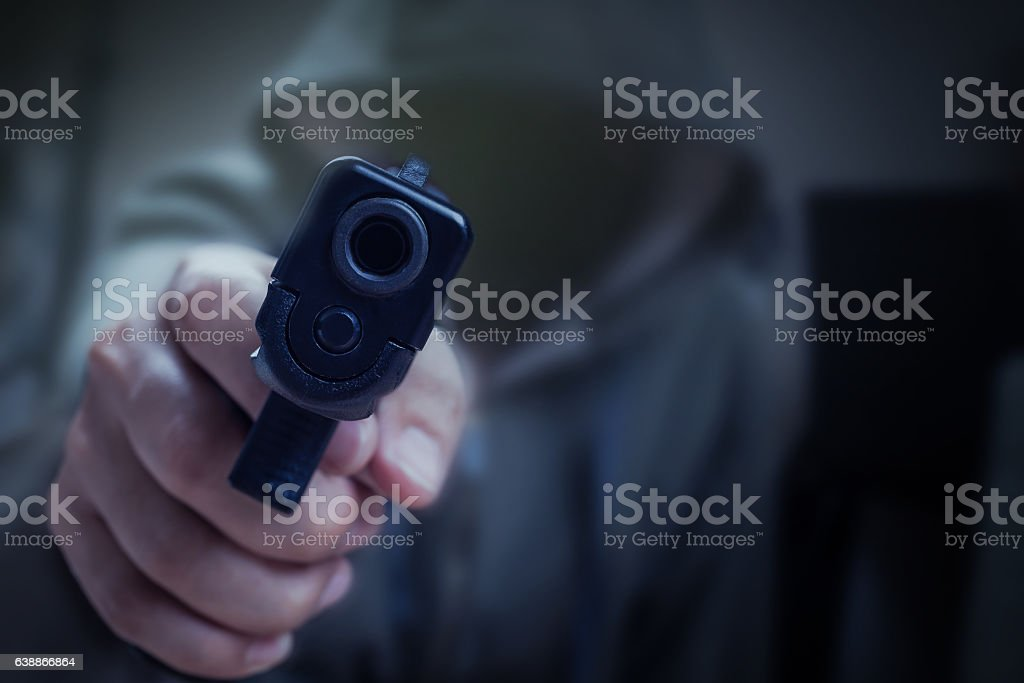 gun in hand and pointing with killer, safety stock photo
