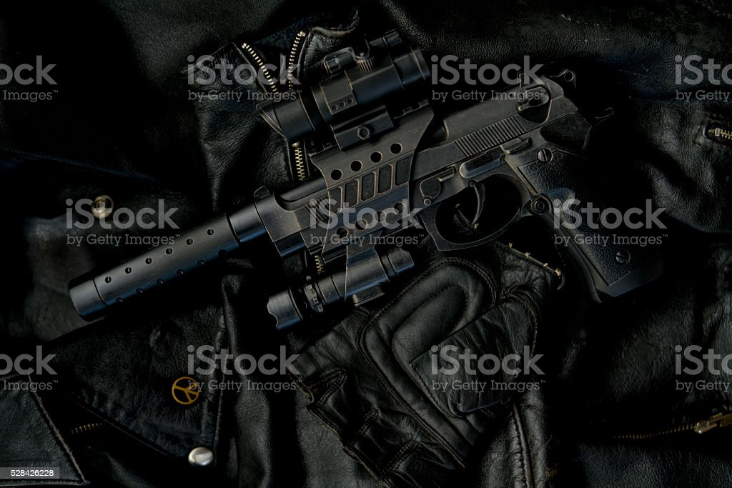 gun leather and peace stock photo