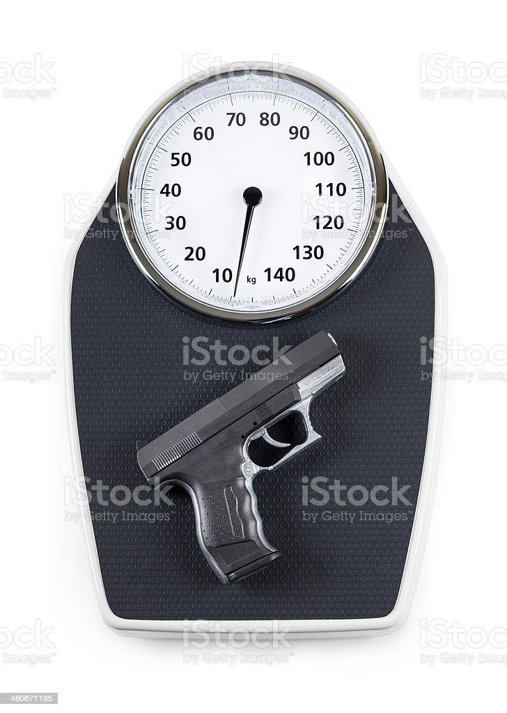 Gun auf einer Skala – Foto