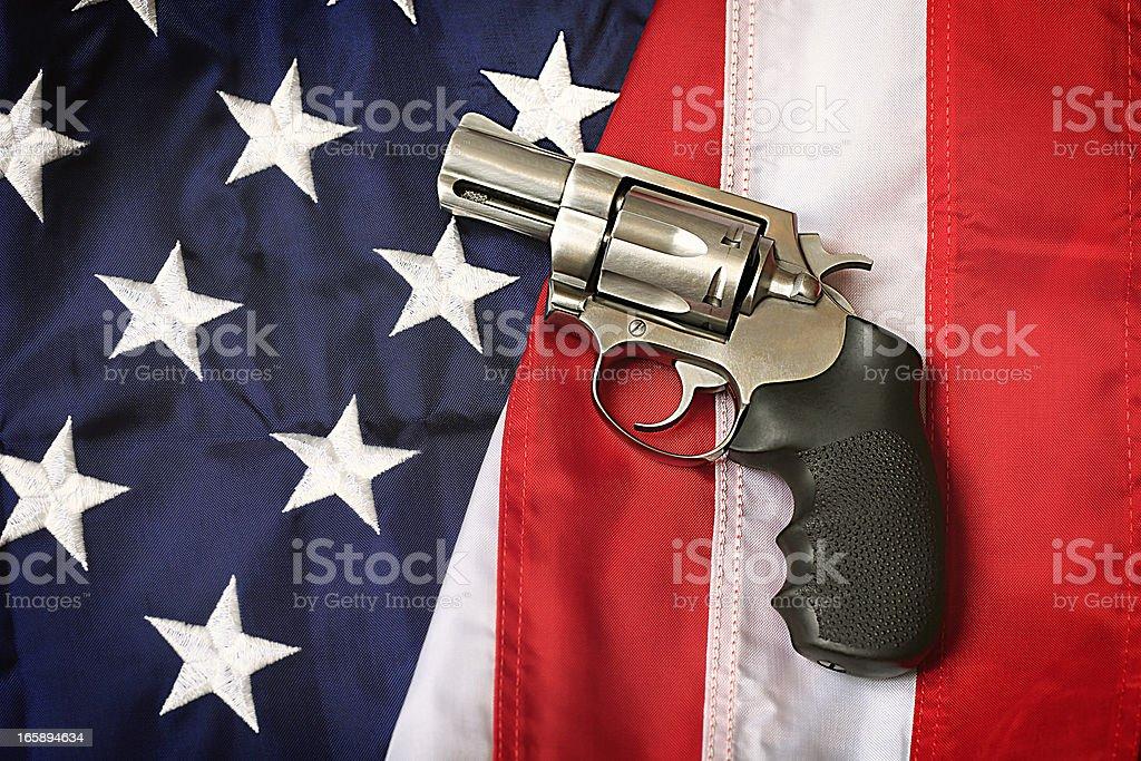 Gun on American Flag stock photo