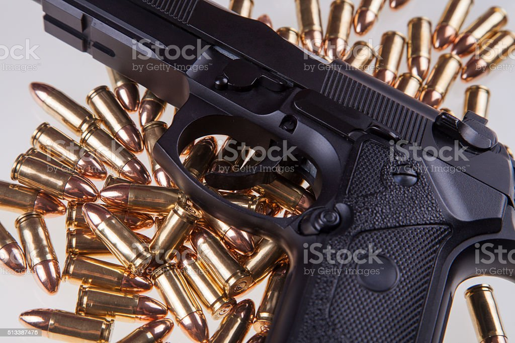 gun on bullets stock photo