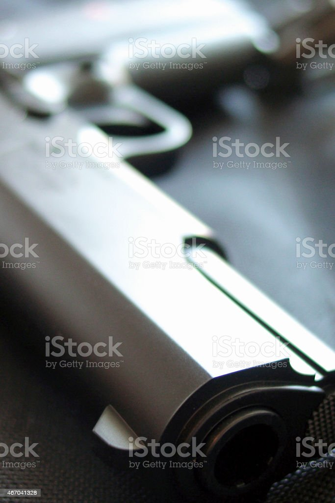 Gun on table with selective focus stock photo