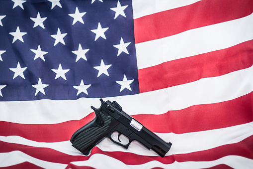 istock Gun on USA flag 509927196