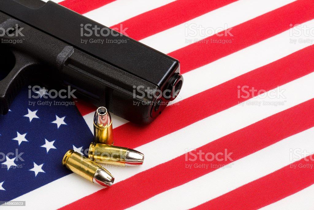 gun over american flag stock photo